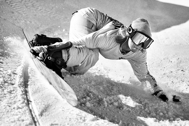christy prior carving on a snowboard