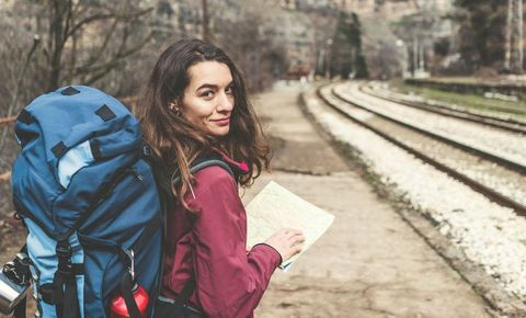 Young woman going on a trip in the mountains