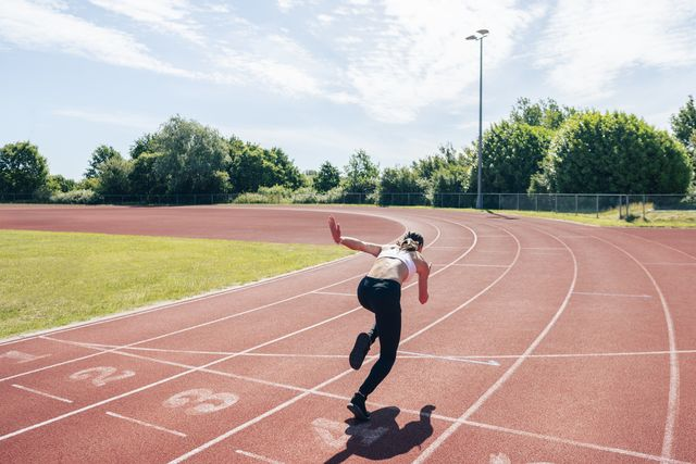 female sprinter taking first stride out of starting position