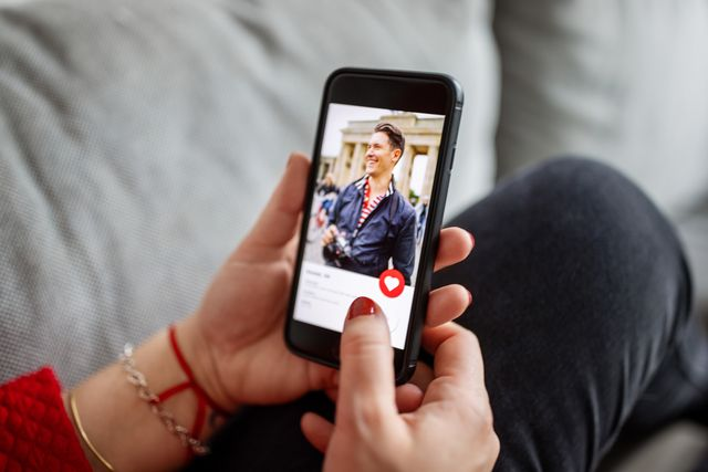 female using a dating app on smart phone