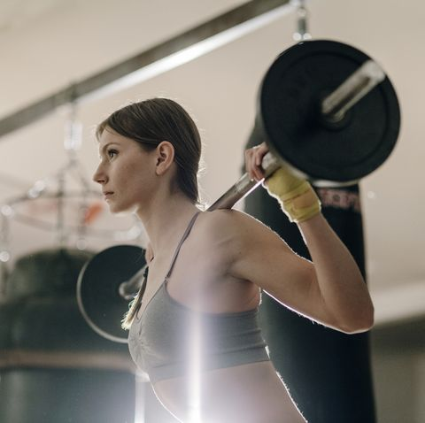 Female weight lifting with barbell