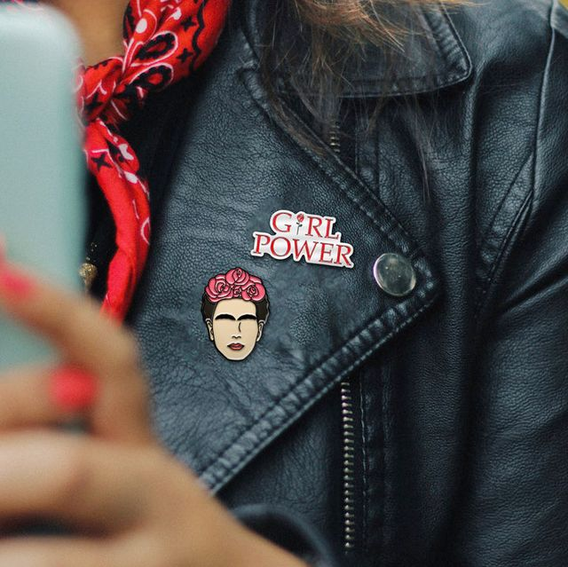 leather jacket with girl power and frida kahlo pins