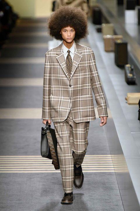 Fashion, Plaid, Clothing, Fashion show, Tartan, Fashion model, Runway, Street fashion, Pattern, Suit,