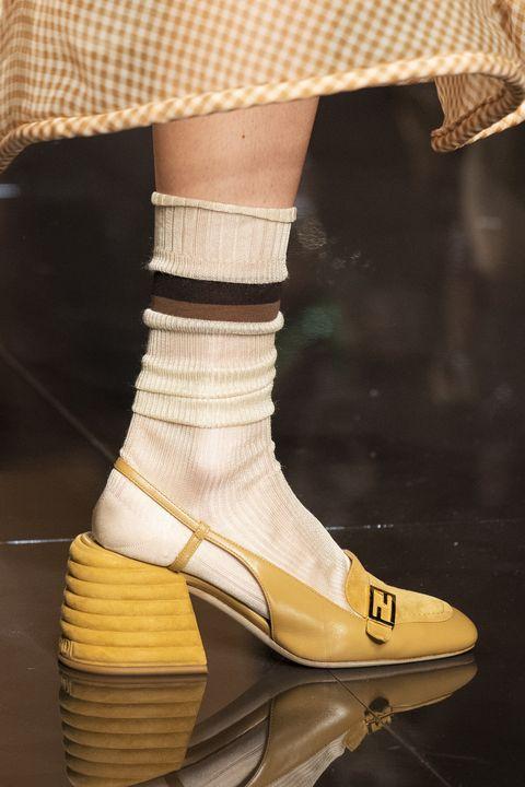 Footwear, Shoe, Yellow, Fashion, Tan, Sock, Beige, Haute couture, Fashion accessory, Plimsoll shoe,