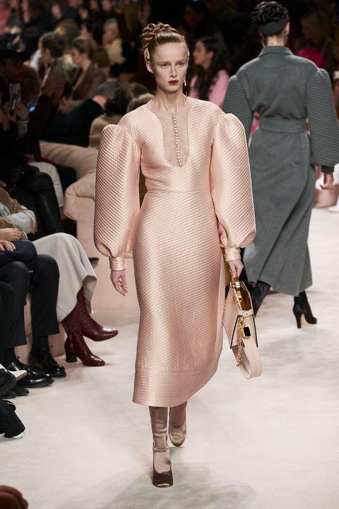 Fashion model, Fashion, Fashion show, Runway, Clothing, Haute couture, Shoulder, Dress, Event, Fashion design,