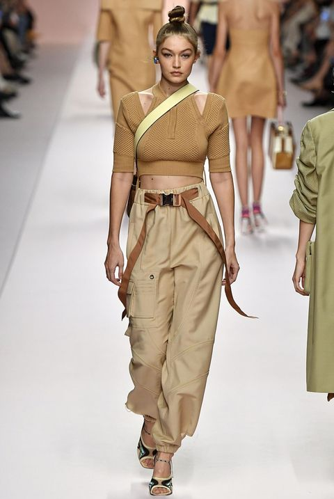 Fashion model, Fashion show, Fashion, Runway, Clothing, Shoulder, Beige, Khaki, Human, Joint,