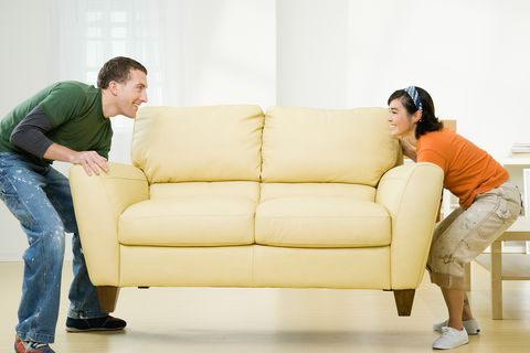 Furniture, Couch, Yellow, Sitting, Sofa bed, Comfort, Leg, Room, Living room, Gesture,