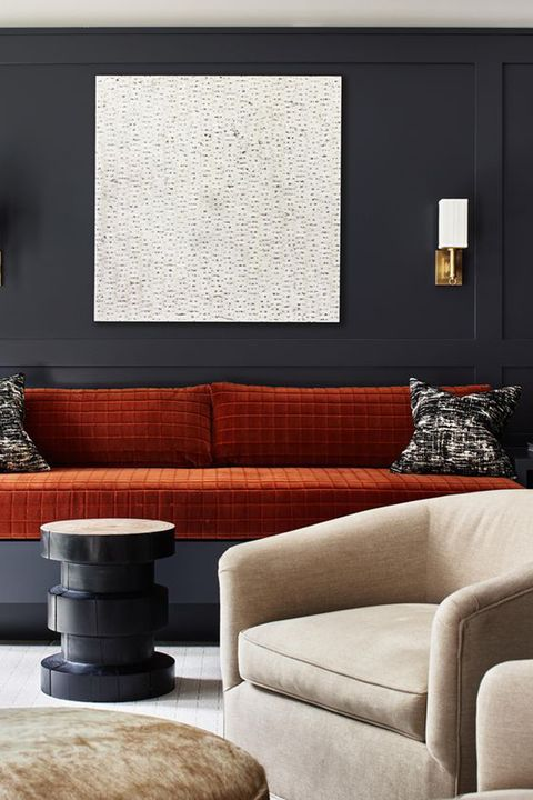 blue wallpaper, orange couch