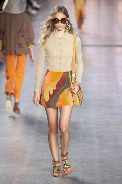 Fashion model, Fashion show, Fashion, Clothing, Runway, Yellow, Street fashion, Footwear, Eyewear, Orange,