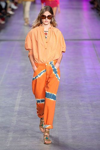 Fashion model, Fashion show, Fashion, Runway, Orange, Clothing, Eyewear, Yellow, Footwear, Shoulder,