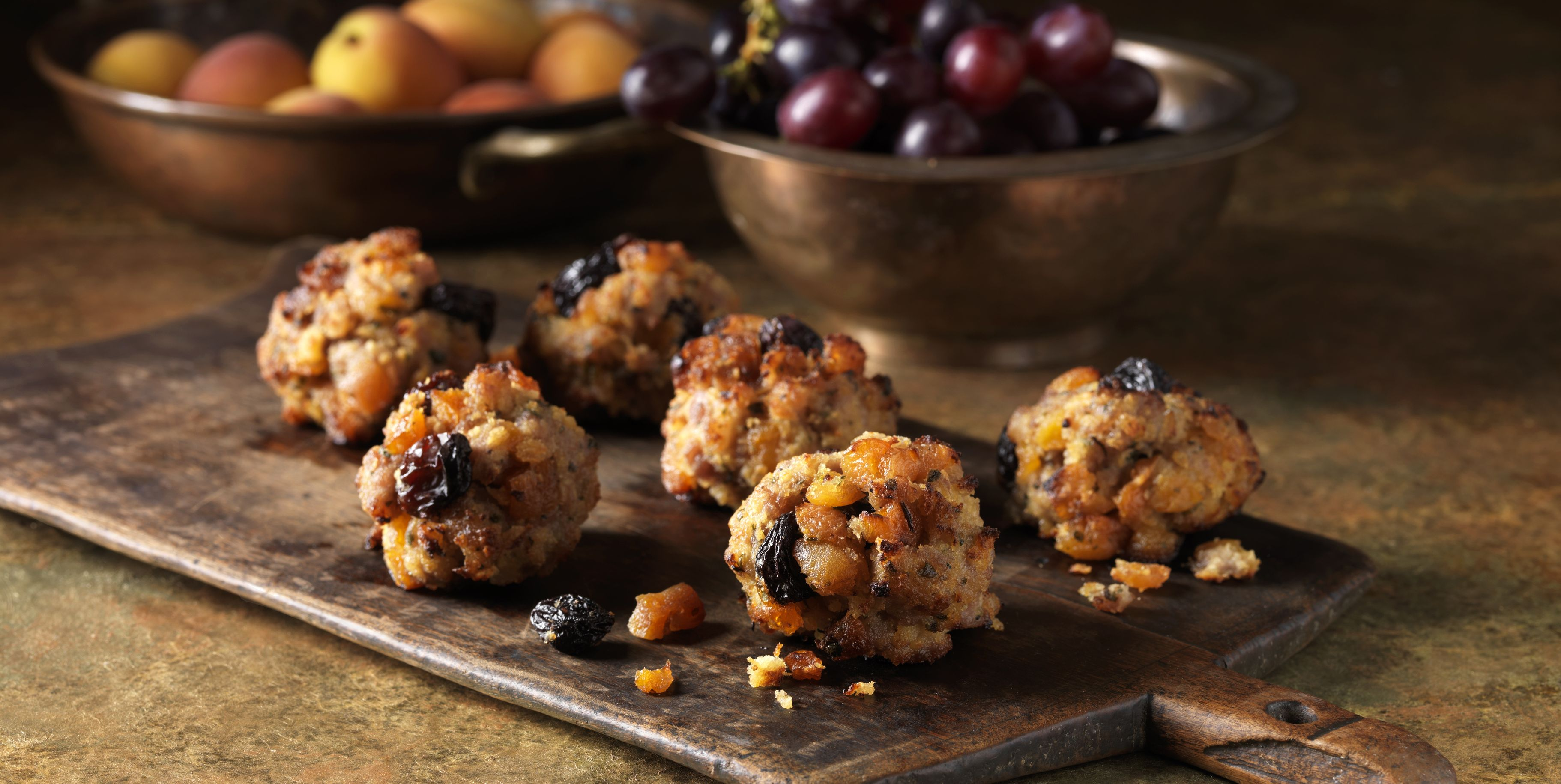 Festive Christmas ingredients of pork, apricot & jumbo flamed raisin stuffing with red grapes and apricots