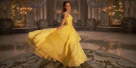 Lighting, Hairstyle, Yellow, Dress, Shoulder, Textile, Flooring, Floor, Gown, Formal wear,