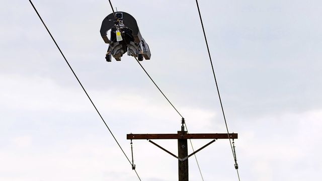 a robot crawling along a power line