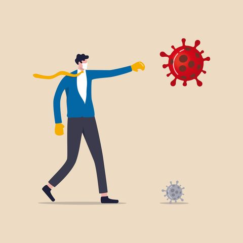 fighting for business to survive and stop covid 19 coronavirus outbreak crisis concept, confident businessman leader wearing suit with boxing gloves fighting with covid 19 virus pathogen