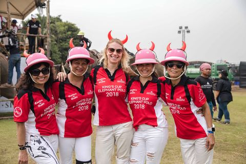 Team, Red, Social group, Pink, Tourism, Recreation, Team sport, Uniform, Style, Games,