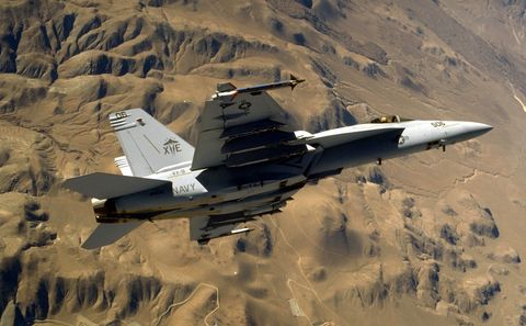 An F/A 18E Super Hornet Strike Fighter Banks Into A Turn During Operation