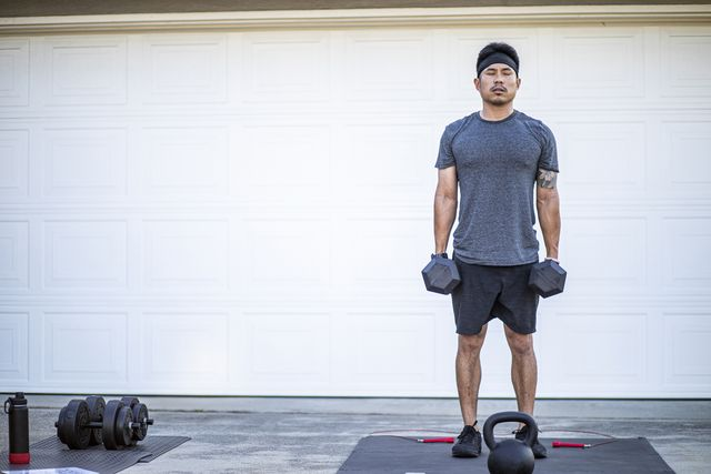 filipino man working out at home