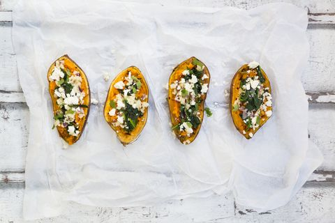 Filled sweet potato with spinach, red onion, couscous, feta and coriander