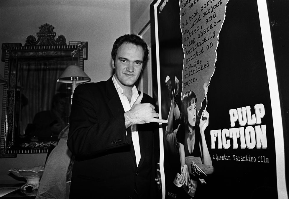 Pulp Fiction (1994) Tarantino stands beside a Pulp Fiction poster showcasing Thurman's iconic haircut for the film. The movie showcases several different stories of crime in L.A., which Tarantino tells in his iconic nonlinear style.