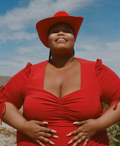 Red, Clothing, Abdomen, Trunk, Lip, Muscle, Headgear, Neck, Photography, Sun hat,