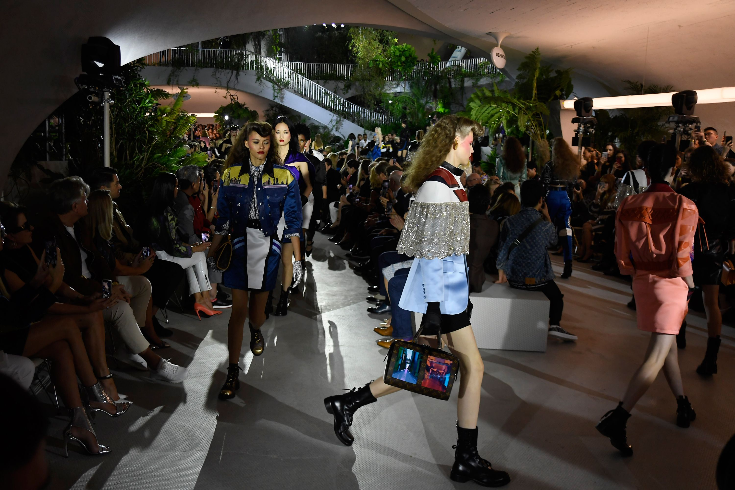 Models debuted futuristic Louis Vuitton handbags outfitted with screens.