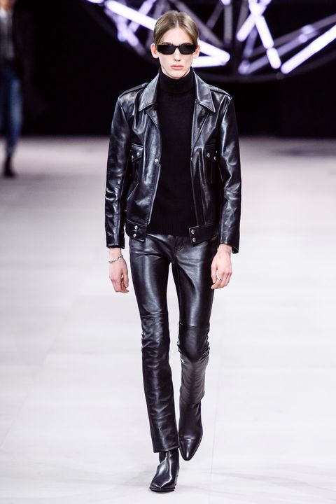 Fashion model, Fashion, Fashion show, Clothing, Runway, Leather, Leather jacket, Jacket, Outerwear, Human,