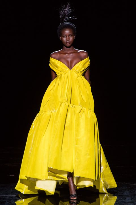 Fashion model, Yellow, Fashion, Clothing, Dress, Fashion show, Fashion design, Haute couture, Runway, Formal wear,