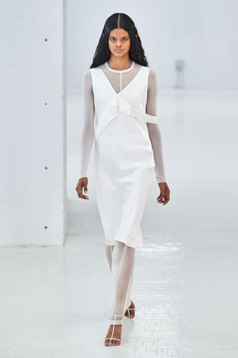 Fashion model, Fashion show, White, Runway, Clothing, Fashion, Shoulder, Dress, Neck, Beauty,