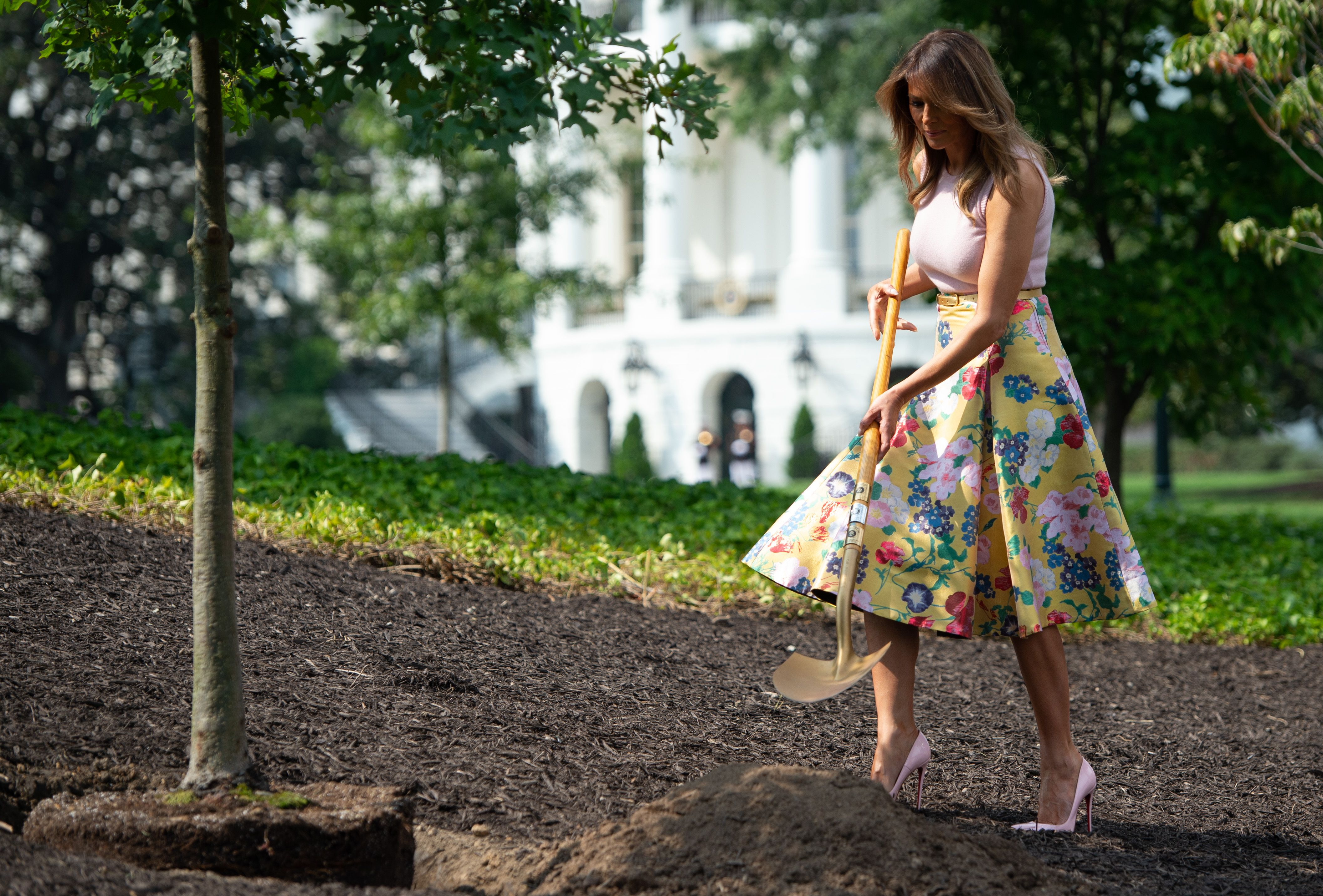 melania trump planted a tree with a golden shovel wearing a 4 000