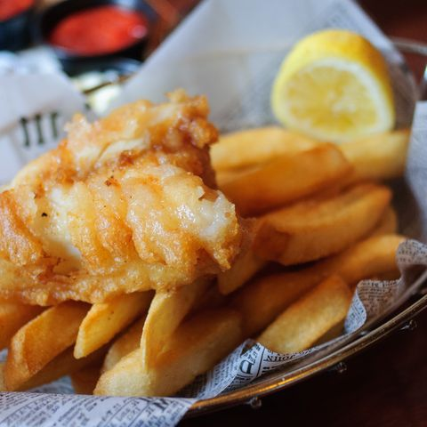 Fish and chips in a basket with a lemon