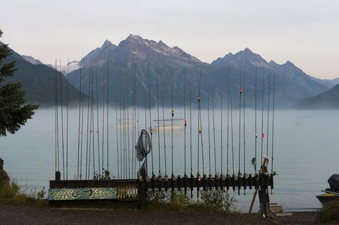 Fishing rods on the beach at Redoubt Mountain Lodge on Lake...