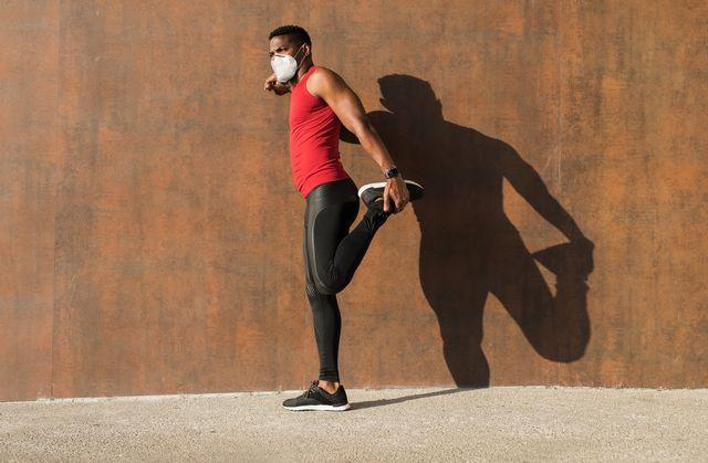 fit black sporty man training in the city under coronavirus pandemic
