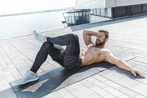 fit fitness man doing fitness exercises outdoors at city