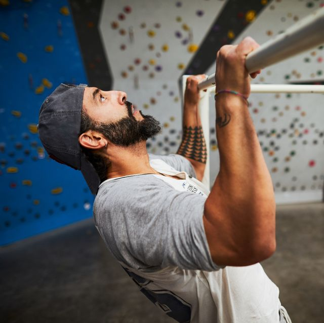 fitness and warm up in climbing gym, doing chinups