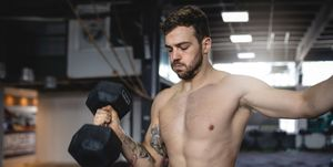 Fitness athlete doing weighted arm workout