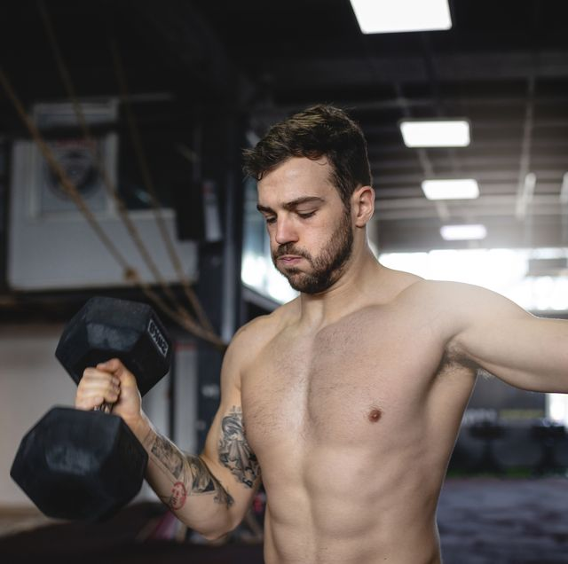 fitness athlete doing dumbbell arm workout