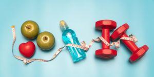 Fitness equipment. Healthy food. water,apple