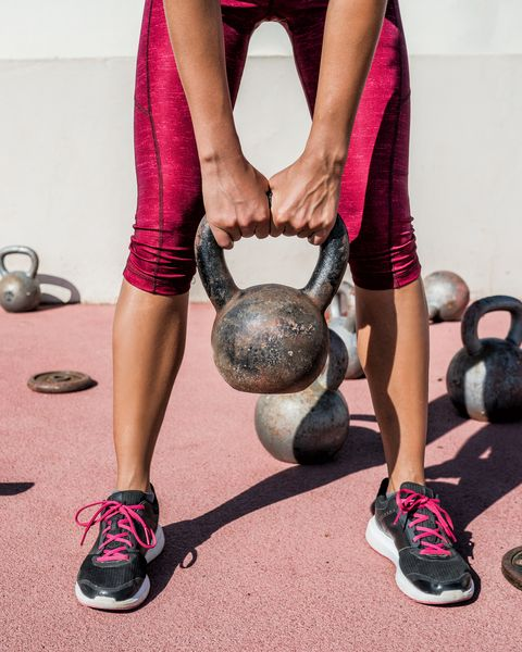 Fitness gym woman weightlifting kettlebell weight
