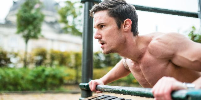 fitness man doing push ups at the outdoors park