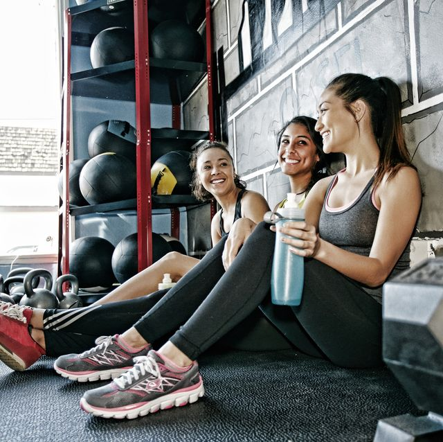 women resting together in gym