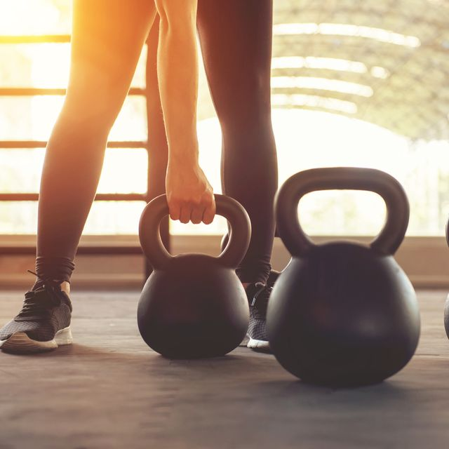 Fitness training with kettlebell in sport gym.