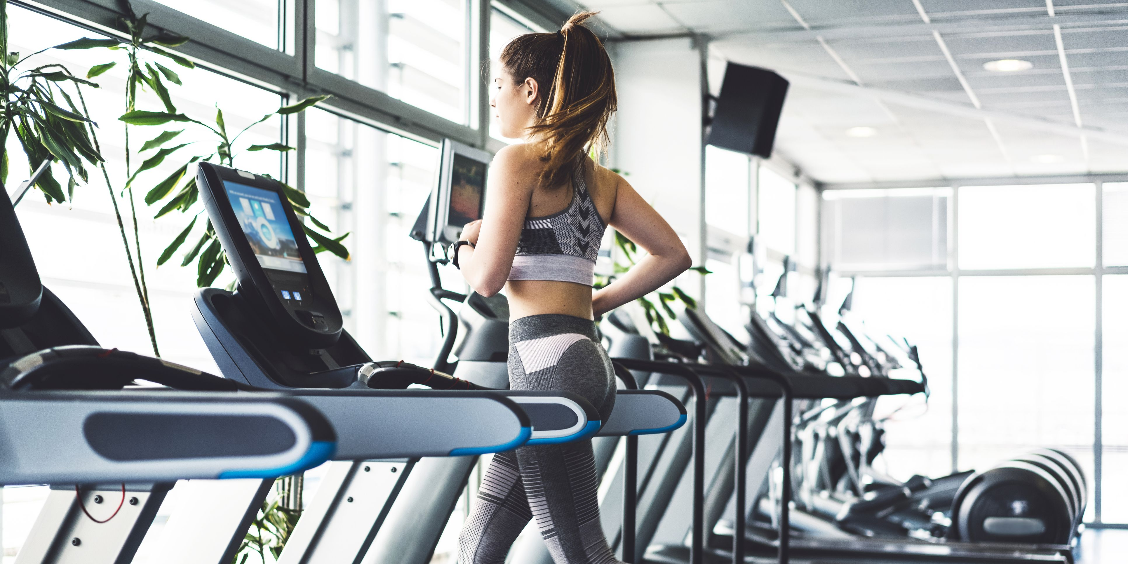 Fitness woman doing a cardio session on a treadmill