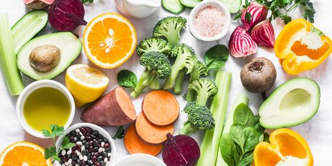 five best vitamins for beautiful skin products with vitamins a, b, c, e, k   broccoli, sweet potatoes, orange, avocado, spinach, peppers, olive oil, dairy, beets, cucumber, beens flat lay, top view