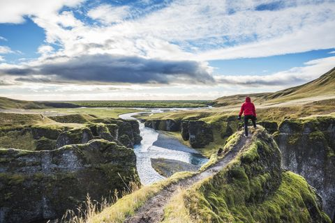 Fjadrargljufur, Iceland, Europe. A man admires the panorama views.