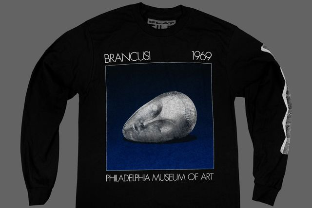 black t shirt with brancusi sculpture of a human head
