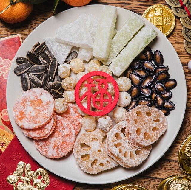 flat lay chinese new year traditional snacks with red envelops
