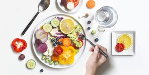Flat lay colourful vegan food healthy eating lifestyle still life.