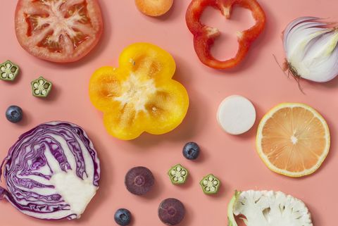 Flat lay conceptual vegan food on pastel colour background.