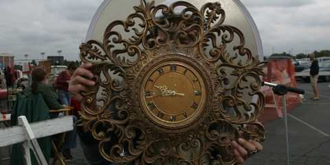 Flea market shopping, a shy Sugi Satoshi with an ornate clock purchased for $20. at the Long Beach