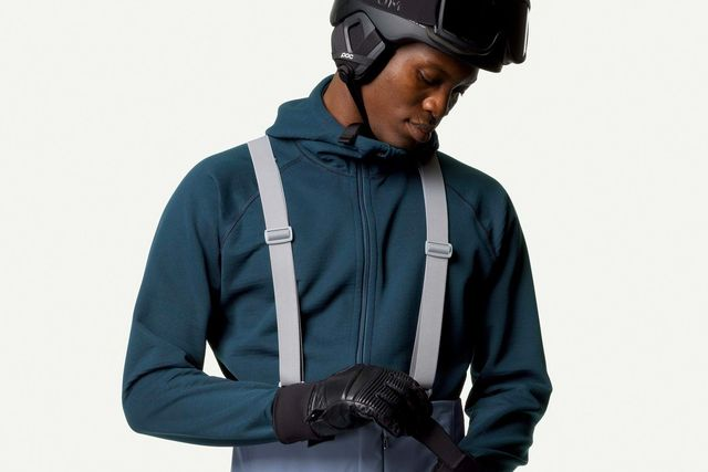 a man wearing a blue fleece and a ski helmet